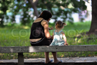 Nurse with a child sitting on the bench