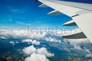 An aerial view from an airplane over blue sky