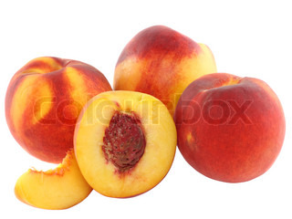 A few peaches with slice of one, on white background. Isolated