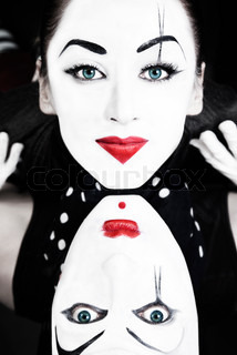 Portrait of two mimes with blue eyes close up