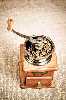 a vintage photo of coffee mill