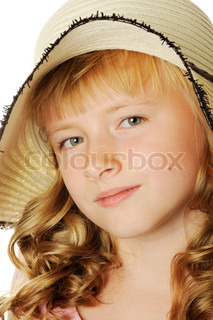 Beautiful happy girl with summer hat on, isolated on white