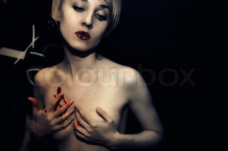 young naked girl with blood on her lips and body