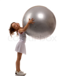 little girl holding a big gray ball in the hands of