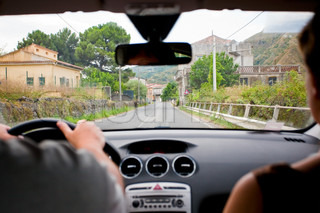 driving a car on rural road in Italy