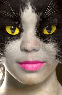 catwoman with brightly yellow eyes.