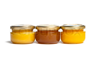 Jars of honey. Isolated on white background.