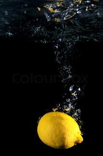 Lemon under water. Close up. Macro shot.