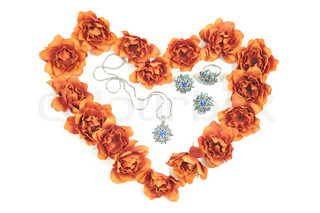 beautiful jewelry set and  flowers around in heart shape