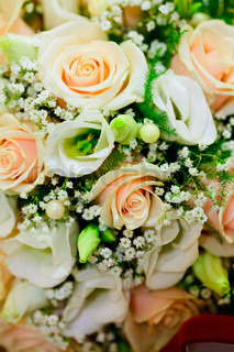 Wedding bouquet from pink roses closeup