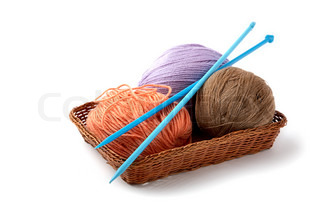 Balls of a yarn knitting spokes in wooden box