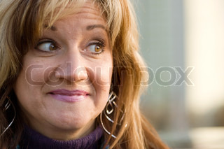 A pretty middle aged woman with a very sincere smile.