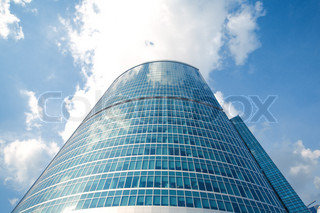 glass building with sky and clouds