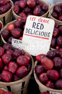 Bushels full of fresh red delicious apples for sale. Shallow depth of field.