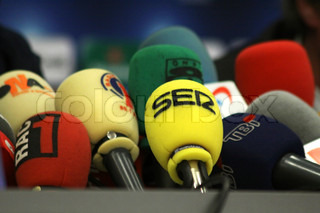 KYIV, UKRAINE - DECEMBER 8, 2009: Microphones on a table during press-conference before UEFA Champions League football match between Dynamo Kyiv and FC Barcelona on December 8, 2009 in Kyiv, Ukraine