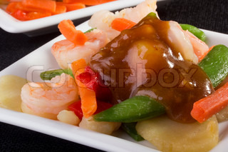 Close-up photograph of a shrimp salad on a white plate.