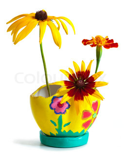 Bright flower bouquet in painted pot isolated on white