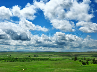 summer landscape with green fields ,mountains and beautiful sky