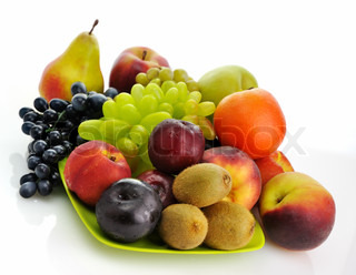 assortment of fresh fruits on a green dish