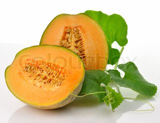 A fresh melon with leaves on white background