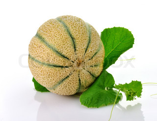 A fresh and delicious melon  with leaves  on white background