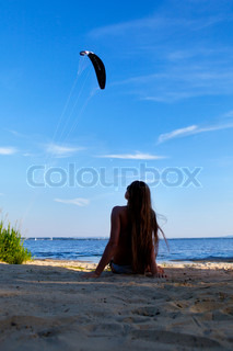 girl lying on a beach at sunset