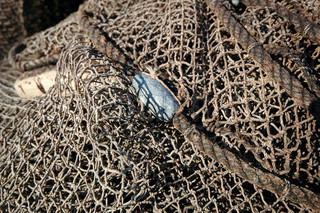 Fishing net is drying in the sun.