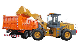 The image of wheel tractor-loader loads the truck