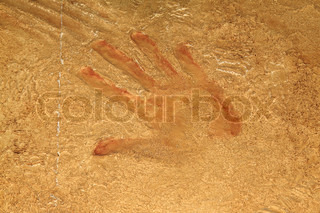 Red hand print on stone background or site