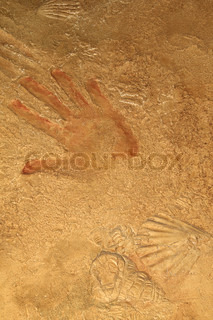 Red hand print on stone background or texture