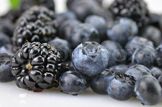 fresh blueberries and blackberries , close up with waterdrops