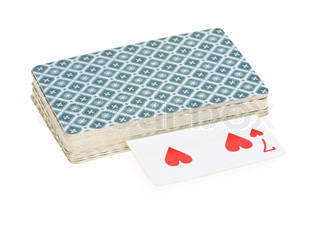 Old pack of playing cards isolated on white