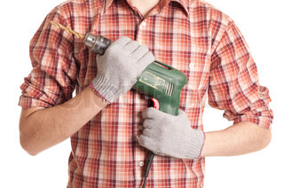 hands handling an electric drilling machine isolated