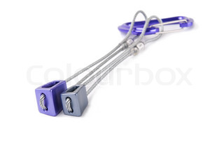 Purple and grey climbing nuts with a carabiner isolated over white