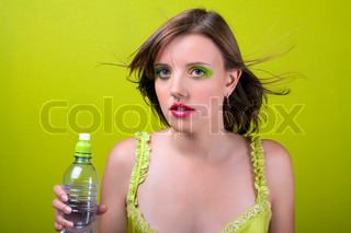 Lady and bottle. On green background.