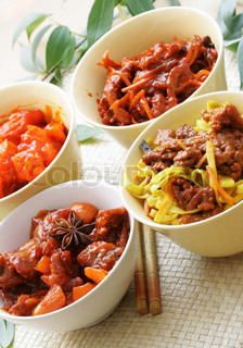 Chinese dishes - pork in sour-sweet sauce, noodles and beef, beef and vegetables, fried pork and vegetables
