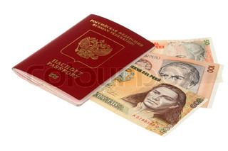 Russian passport and pile of money of Peru are isolated on a white background