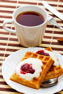 breakfast with soft waffles, sour cream and raspberry