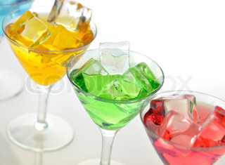 glasses of colorful cold drinks , close up