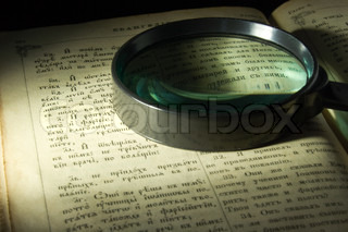 Old bible page and lens