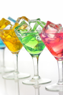 arrangement of colorful cocktails with ice cubes