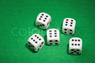 dices. Game cubes on a green background