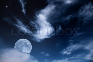 Fantastic night landscape with the moon, clouds and stars