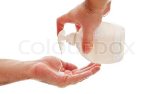 washing hands with liquid soap, white background