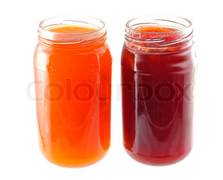 jars  of apricot and strawberry jelly on white background