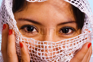 Muslim Woman With A White Cloth Veil Over Her Face