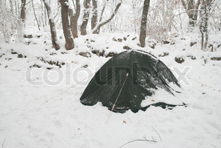 Winter tent camp in the snow forest