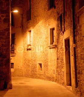 Medieval Deserted Alley At Night With Yellow Street Lamps