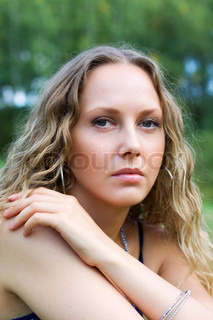 Sad woman against a nature background