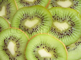 kiwi fruit with a core in the form of heart, suitable for a background